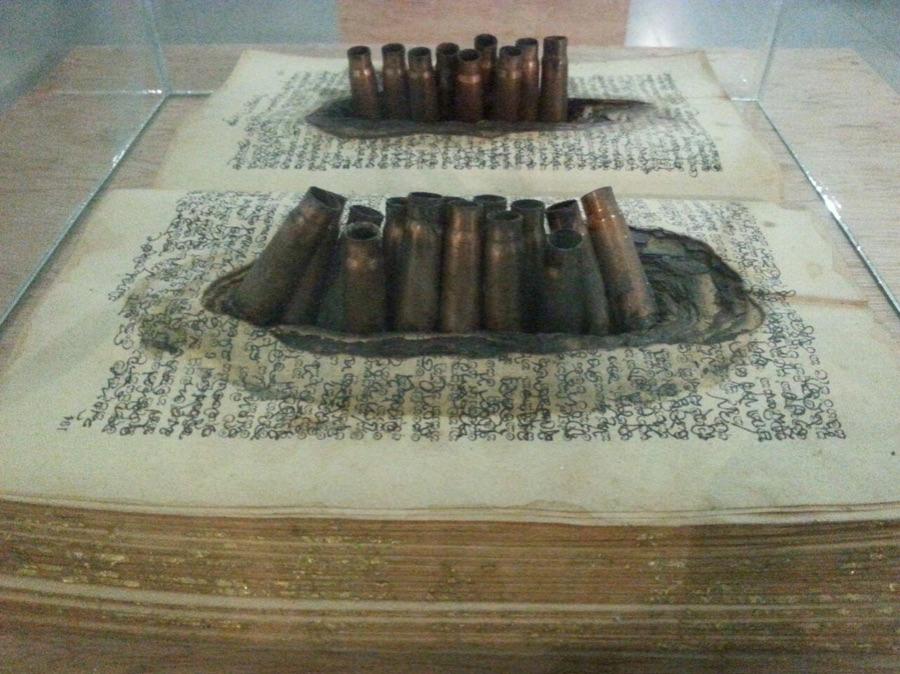 Killing-Book-Old-book-empty-bullets-by-Kingsley-Gunatillake